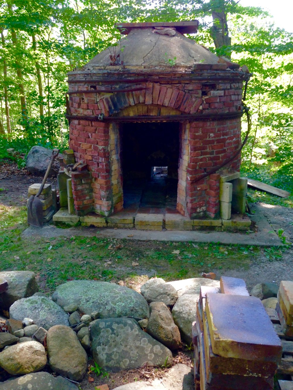 This circular down draught kiln was built in 1980 and was almost as much fun to take down as it was to build .