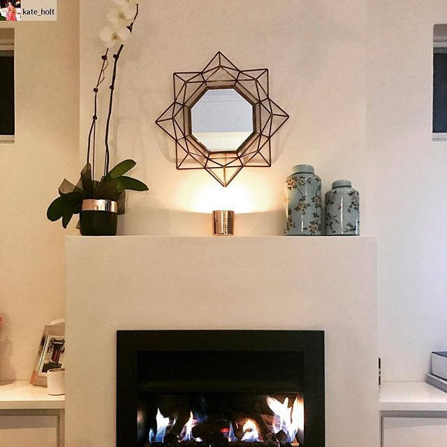 Love from my sister ❤ @kate_holt with a little gold metalic soy candle in the living room. Jealous of that fireplace!  #Repost from @kate_holt with @regram.app ... Home ❤️#holtandsarah #winter #fireplace #candle