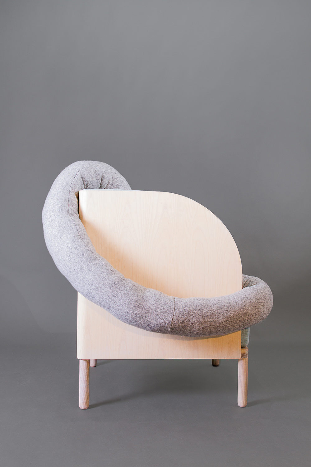 Amanda Ivarsøy Kovacs' chair offers the sitter relaxation and control. The tube shaped pillow serves as a comforting addition.