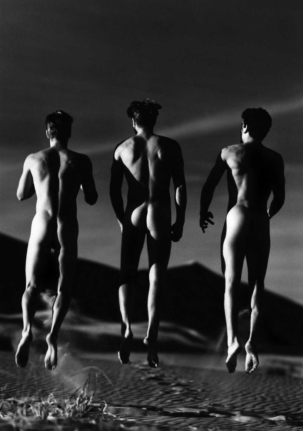 3 Boys Jumping, Kelso Dunes, 1991  by  Greg Gorman