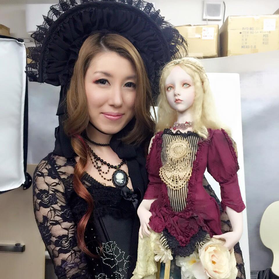 Kobayashi with the doll