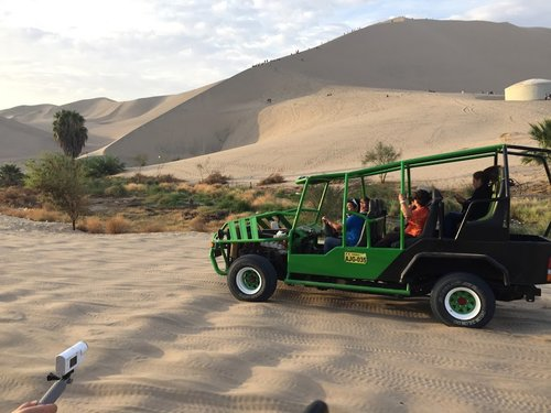The crazy trek up the sand dunes in these buggy's racing to the top!