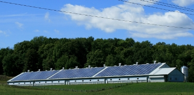 Photo of farm building with solar panels on roof