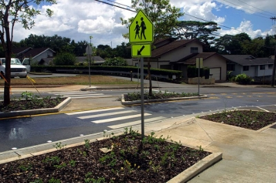 Crosswalk at traffic calming lanes in suburban neighborhood.