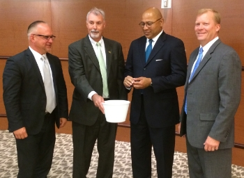 Participating in the drawing, from left, were Commissioner George Hartwick, Tri-County Regional Planning Commission Executive Director Tim Reardon, Controller Timothy DeFoor and Commissioner Mike Pries.