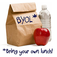 Brown bag lunch with apple and water, with note reading Bring Your Own Lunch.