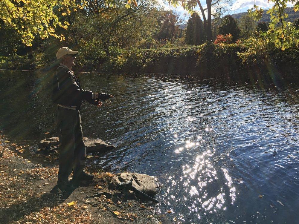 Fisherman trying his luck at pedestrian bridge over Wiconisco Creek in Millersburg