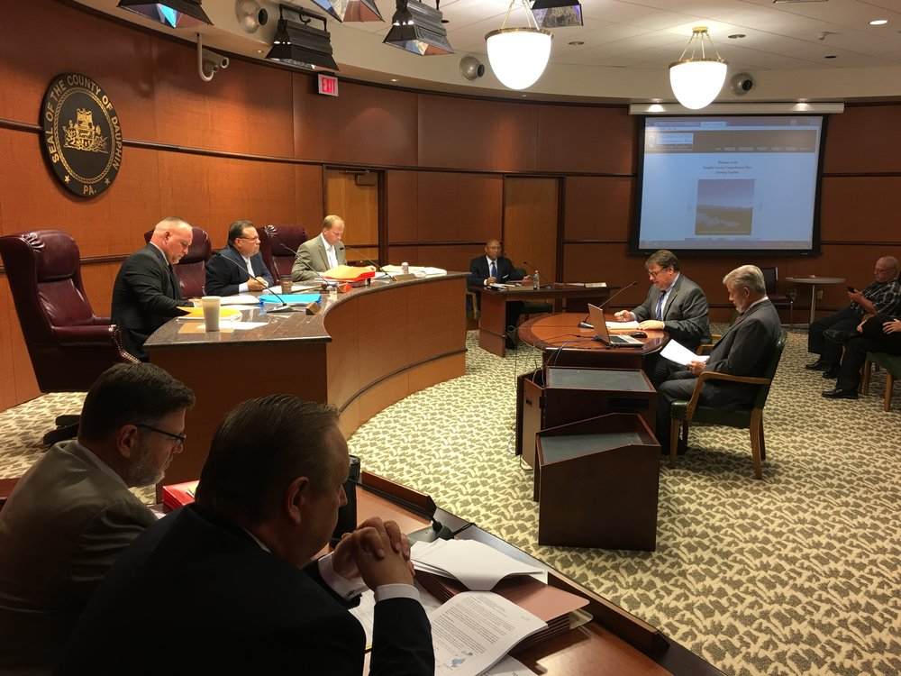 At a 7/12 public hearing of the Dauphin County Commissioners, TCRPC staffers Jerry Duke and Steve Deck, right, offer a presentation on the county's new 10-year comprehensive plan.