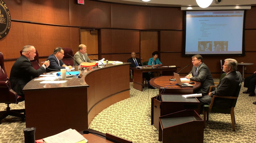 At a July 12 public hearing of the Dauphin County Commissioners, TCRPC staffers Jerry Duke and Steve Deck, right, offer a presentation on the county's new 10-year comprehensive plan. Commissioners George P. Hartwick III, Jeff Haste and Mike Pries, left, unanimously approved the plan.