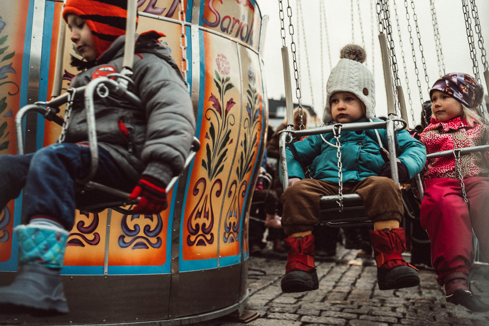 Child sitting in carousel