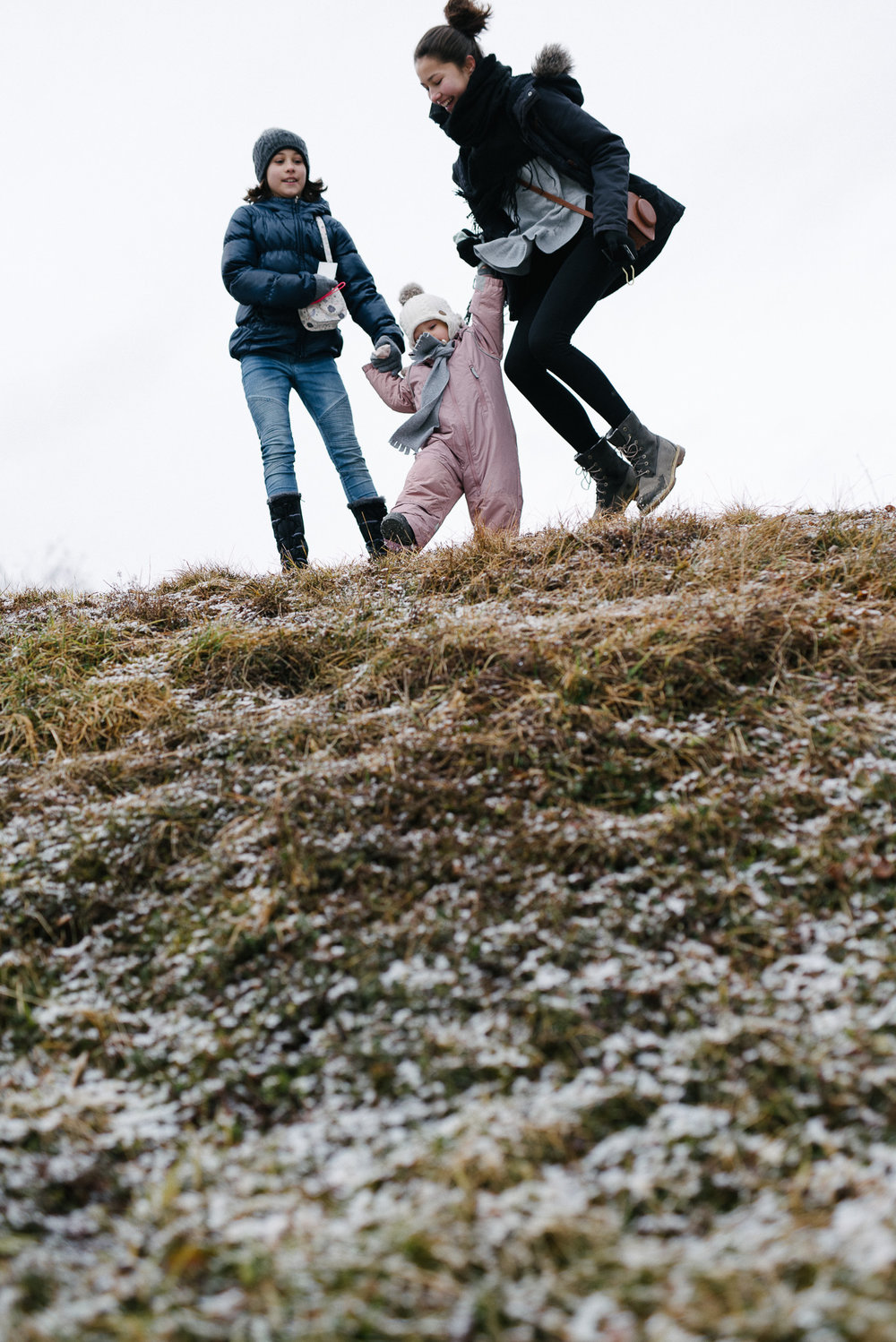 Three children jumping