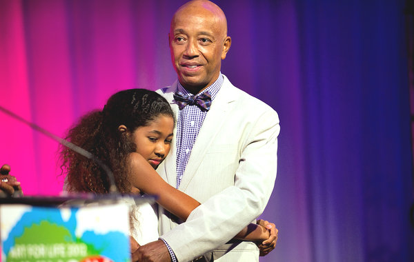 Russell Simmons and his daughter Aoki Lee Simmons, at the Art for Life benefit for his Rush Philanthropic Arts Foundation / Credit: Joshua Bright for The New York Times