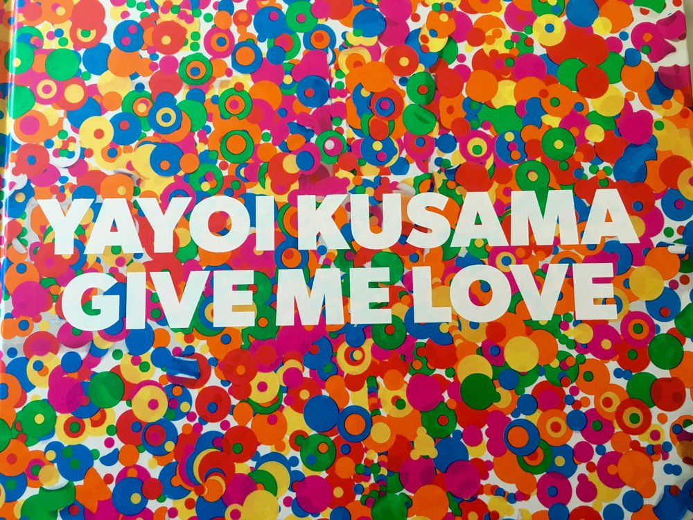 Two weeks ago in Washington, D.C., thanks to a good friend, I got tickets to the sold-out Kusama exhibit at the Hirschhorn Museum. I'm back home in Southern California, but Kusama's powerfully seductive colorful images linger and beckon.  Last night when I couldn't sleep (again), I wandered downstairs, sipped hot tea and looked through the pages of her book Give Me Love.  I wish everyone could read her introduction where this artist writes...And I want to tell people across the earth: Stop nuclear bombs and wars, now see your shining life With my longing for eternity. Having lived in a psychiatric institute for some 40 plus years, Kusama speaks freely about abusive childhood, her mental illness, and her suicide-prone life.  After I googled her and learned that her art explodes from the depths of her mental illness, this new understanding couldn't help but color how I felt about The Obliteration Room, for example.