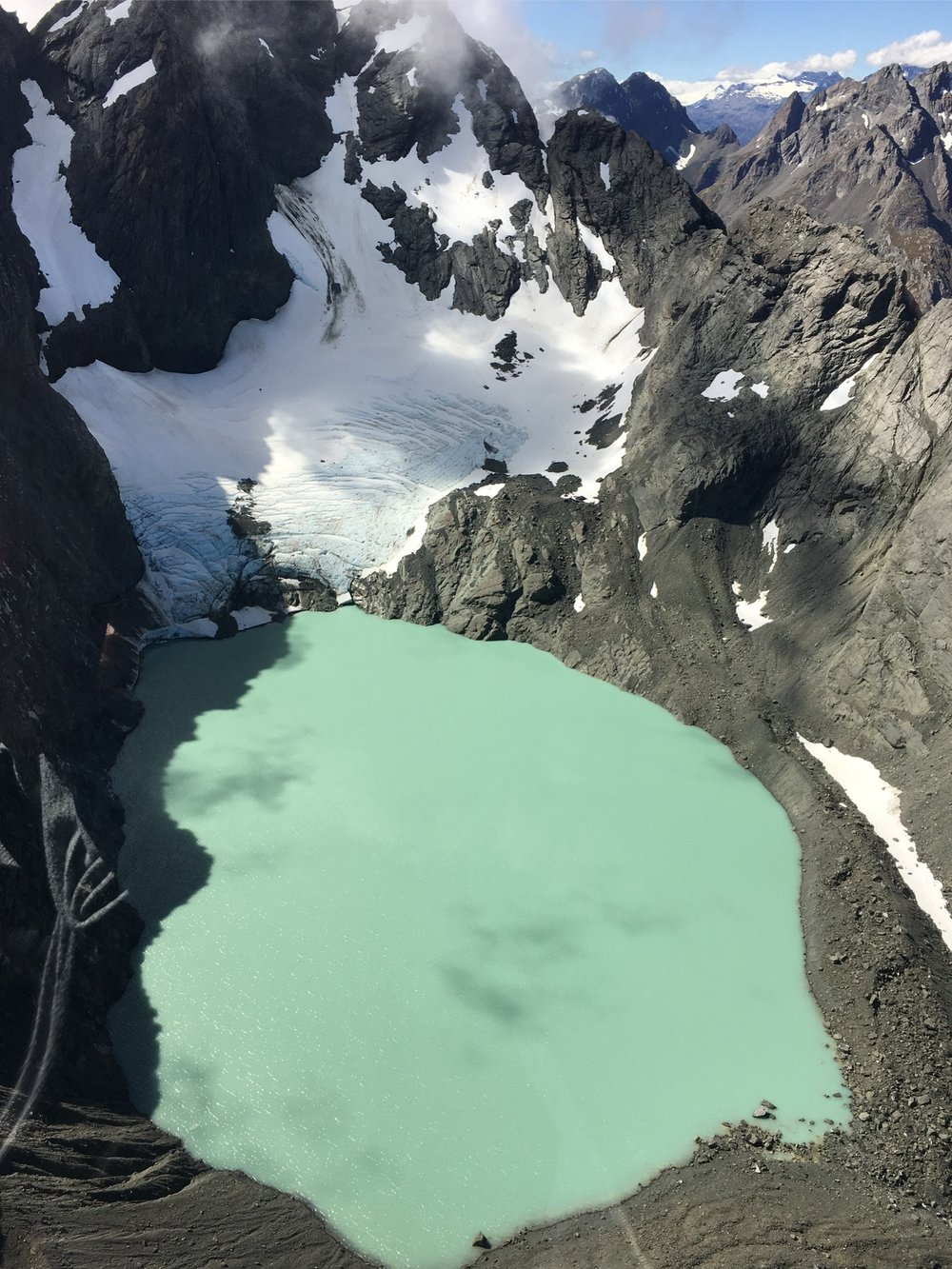 Glacial lake, South Island, New Zealand, as seen from helicopter