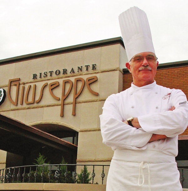 Chef Giuseppe standing in front of the now-closed Ristorante Giuseppe.