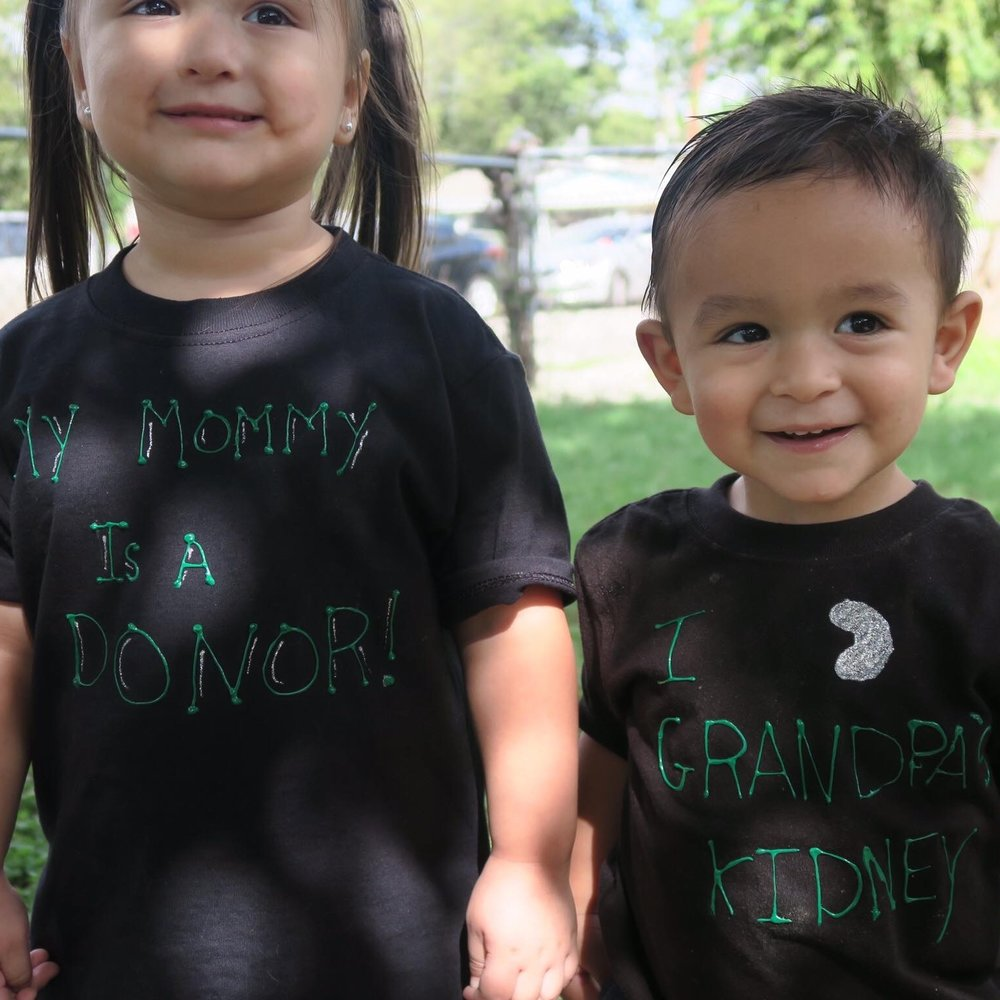 My two youngest showing off how proud they are of their Grandpa and Mommy.