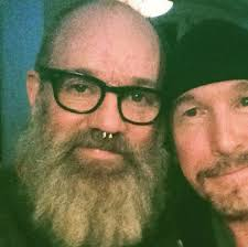 "Early Stipe Cthulhu beard (it has grown) here with ""The Edge"" or U2"