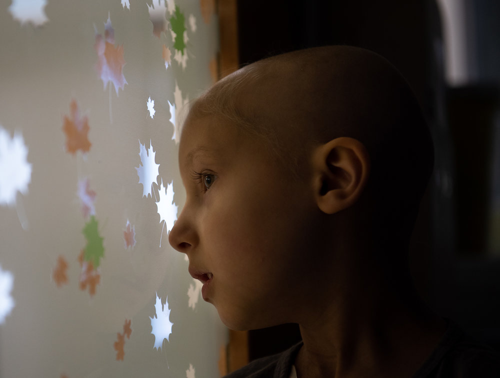 Kailee looks out the door to her hospital room, 'on lookout' for nurse Joe to return with her release paperwork after a 5-day stay over Easter Sunday weekend for inpatient chemotherapy treatment at Golisano Children's Hospital, in Henrietta, NY. In January of 2017, Kailee was diagnosed with her third bout of Rhabdomyosarcoma, a rare pediatric cancer.