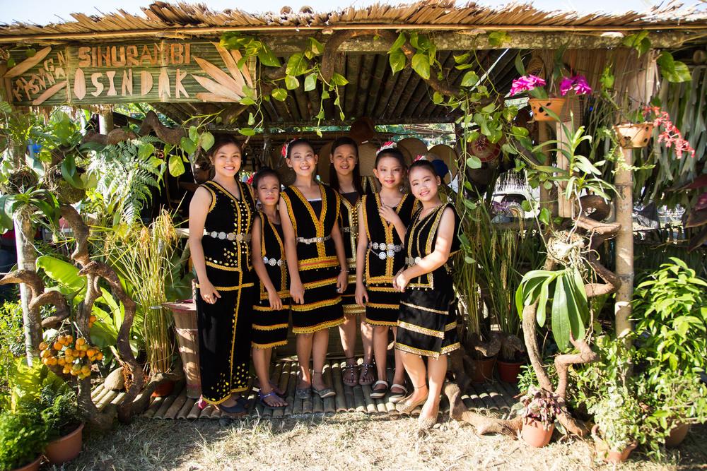 Young women posing at a hut. Credit: Jeremiah Sebastian Photography