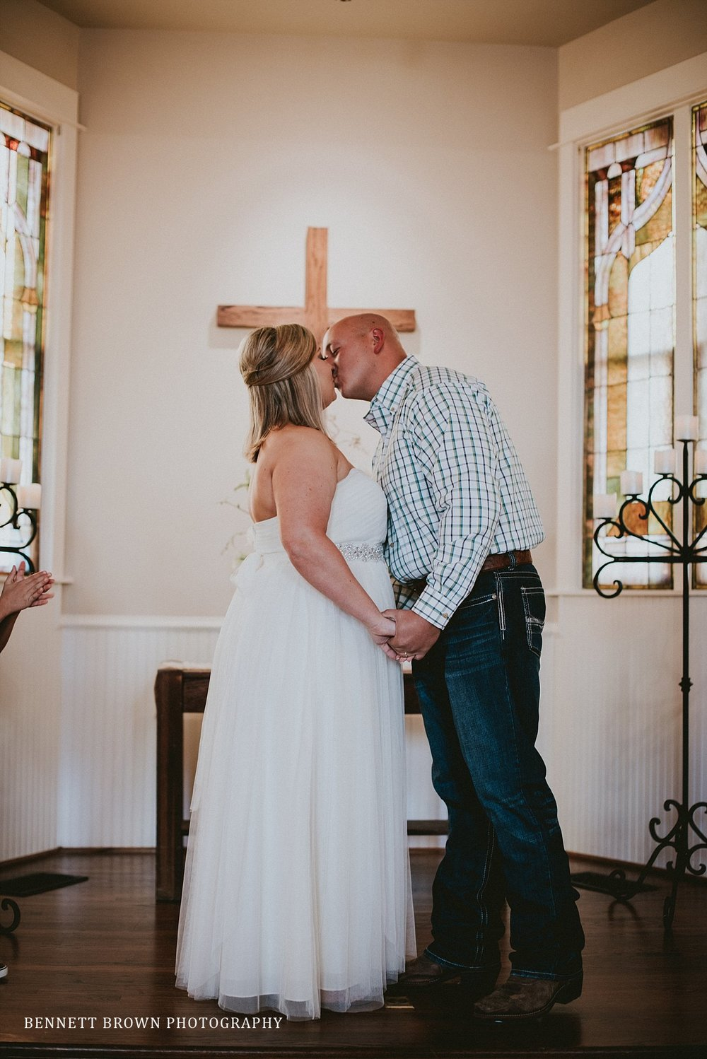 Bennett Brown Photography Chapel Church alter bride groom kiss