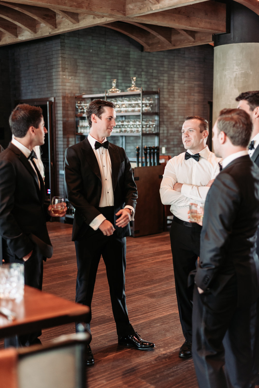 Wedding venue groomsmen Bennett Brown photography wedding groom suit bow tie