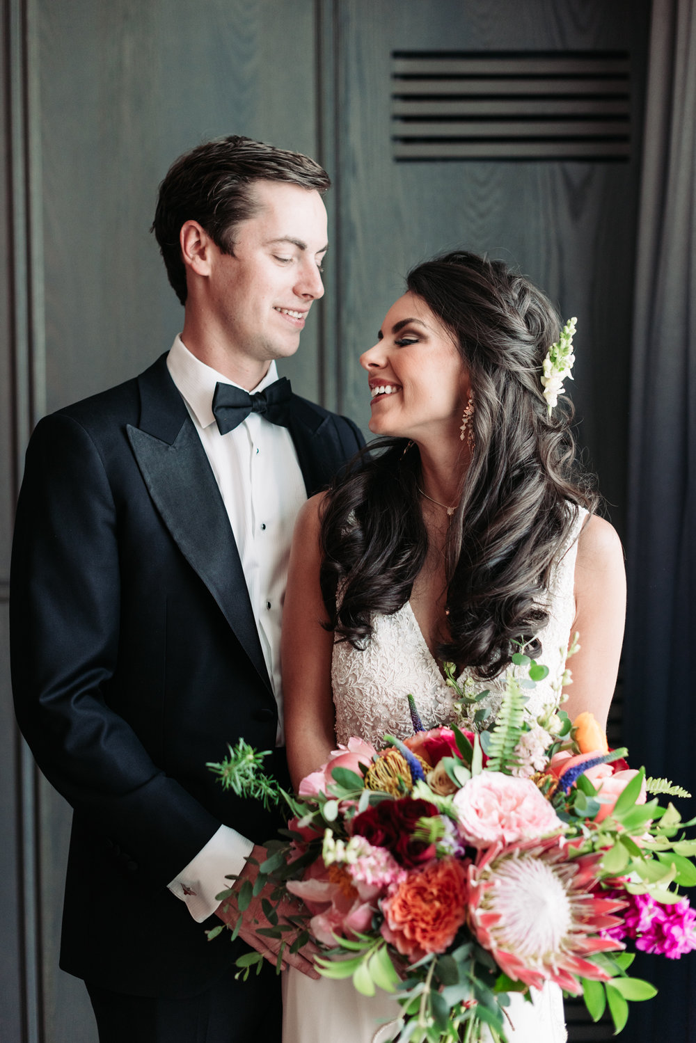 Wedding portrait photography bride groom gown bouquet flowers tuxedo