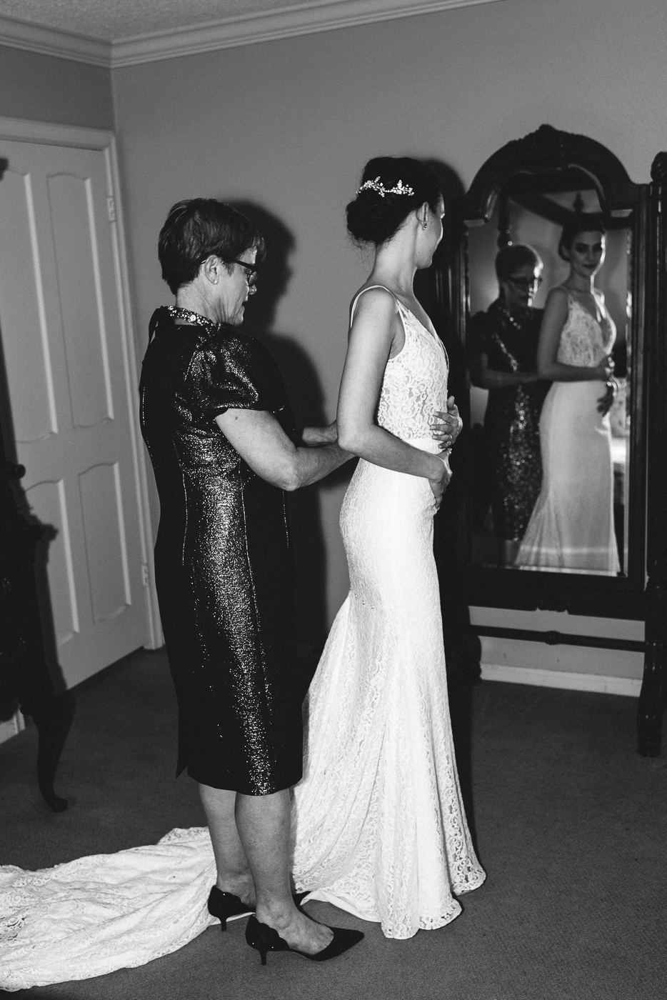 black and white mother and daughter wedding gown v-neck lace getting ready