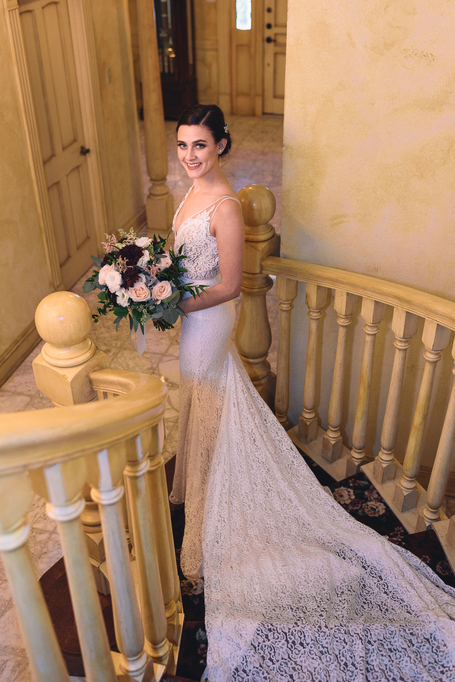 beautiful bride wedding gown bouquet lace train