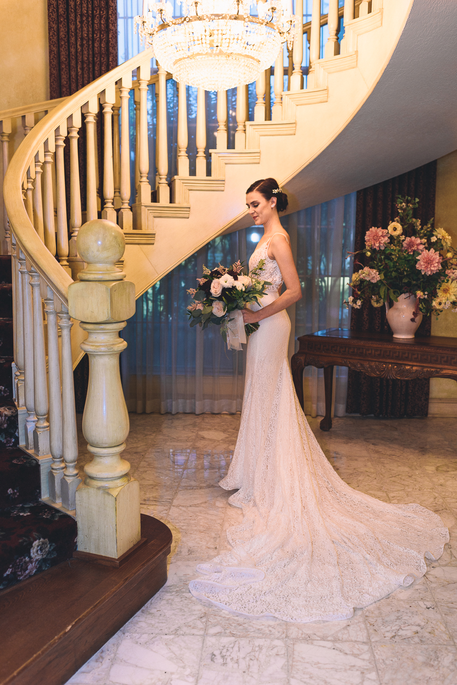 bride spiral staircase bouquet lace train bridal portrait
