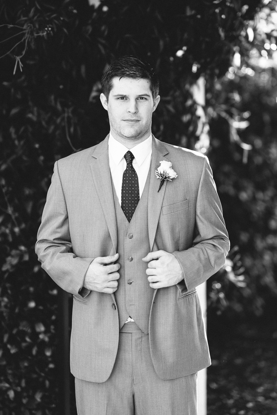 dapper groom suit black and white portrait