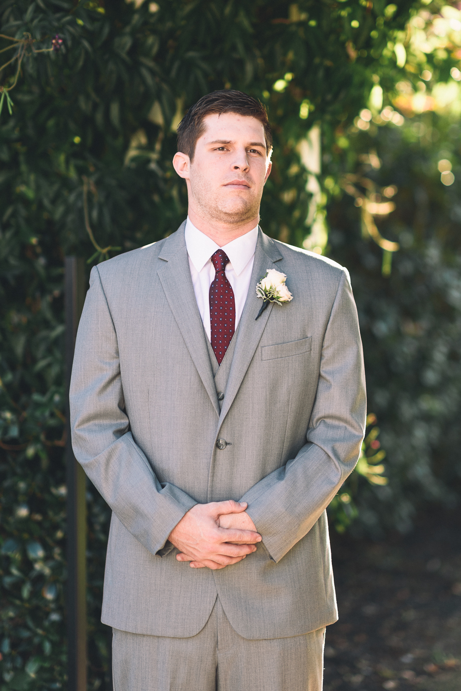 dapper groom grey suit portrait boutonniere