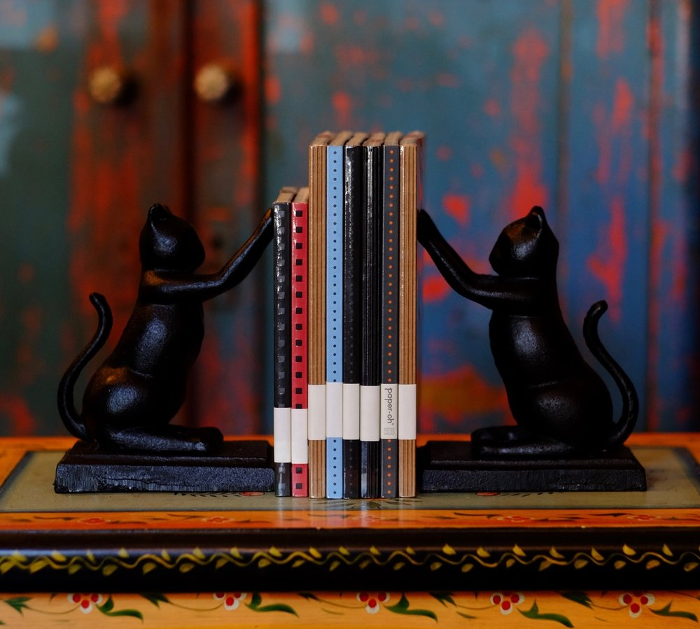 Jones-And-Company-Cat-bookends-notebooks.jpg
