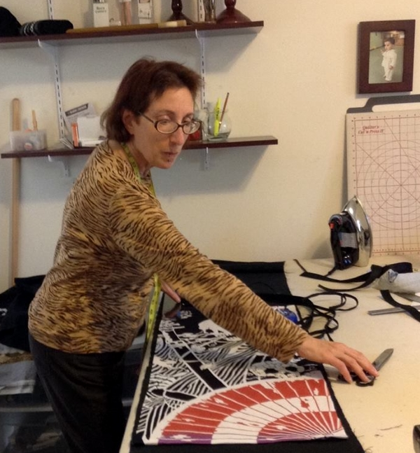 Janet at work in her home studio in inland Mendocino County