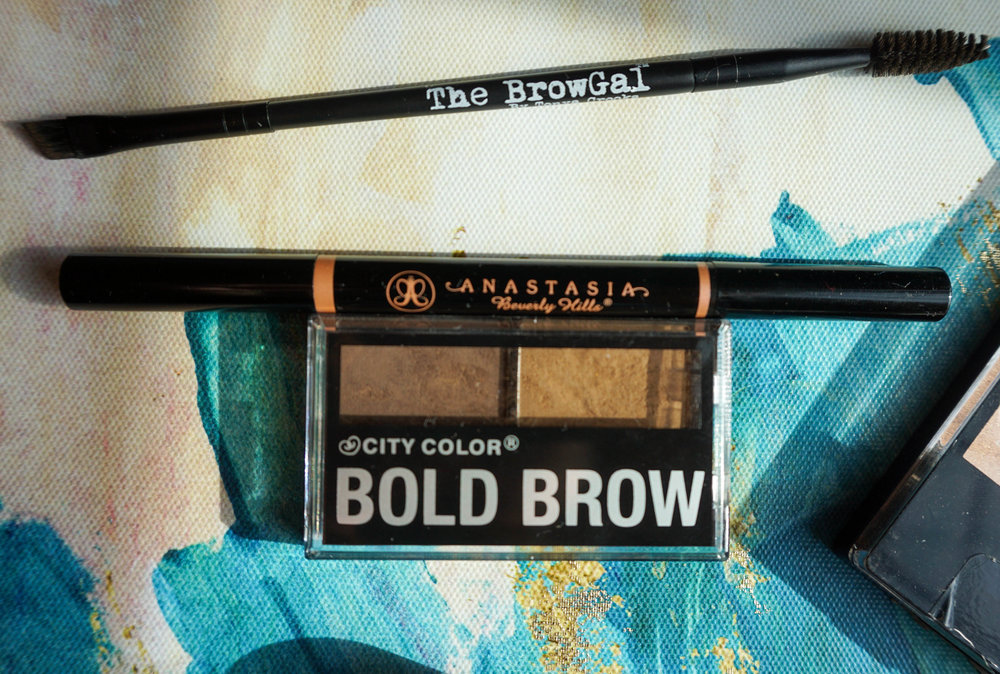 - The BrowGal brush, Anastasia Beverly Hills Brow Definer in Taupe & the City Color bold brow.