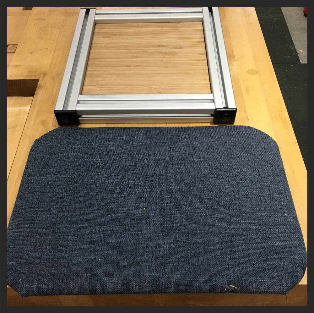 "the top is a prototype of the 8020 panels. This will be how the structural components such as the bed platform will be made. The lower is fabric over 1/4"" ply, illustrating wall panels."