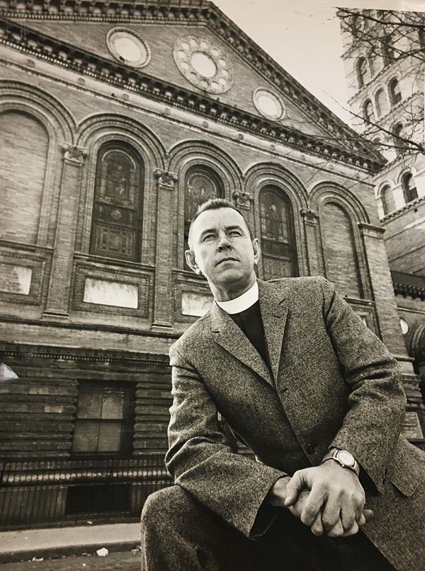 Rev. Howard Moody in front of the Judson. (Fales Library)