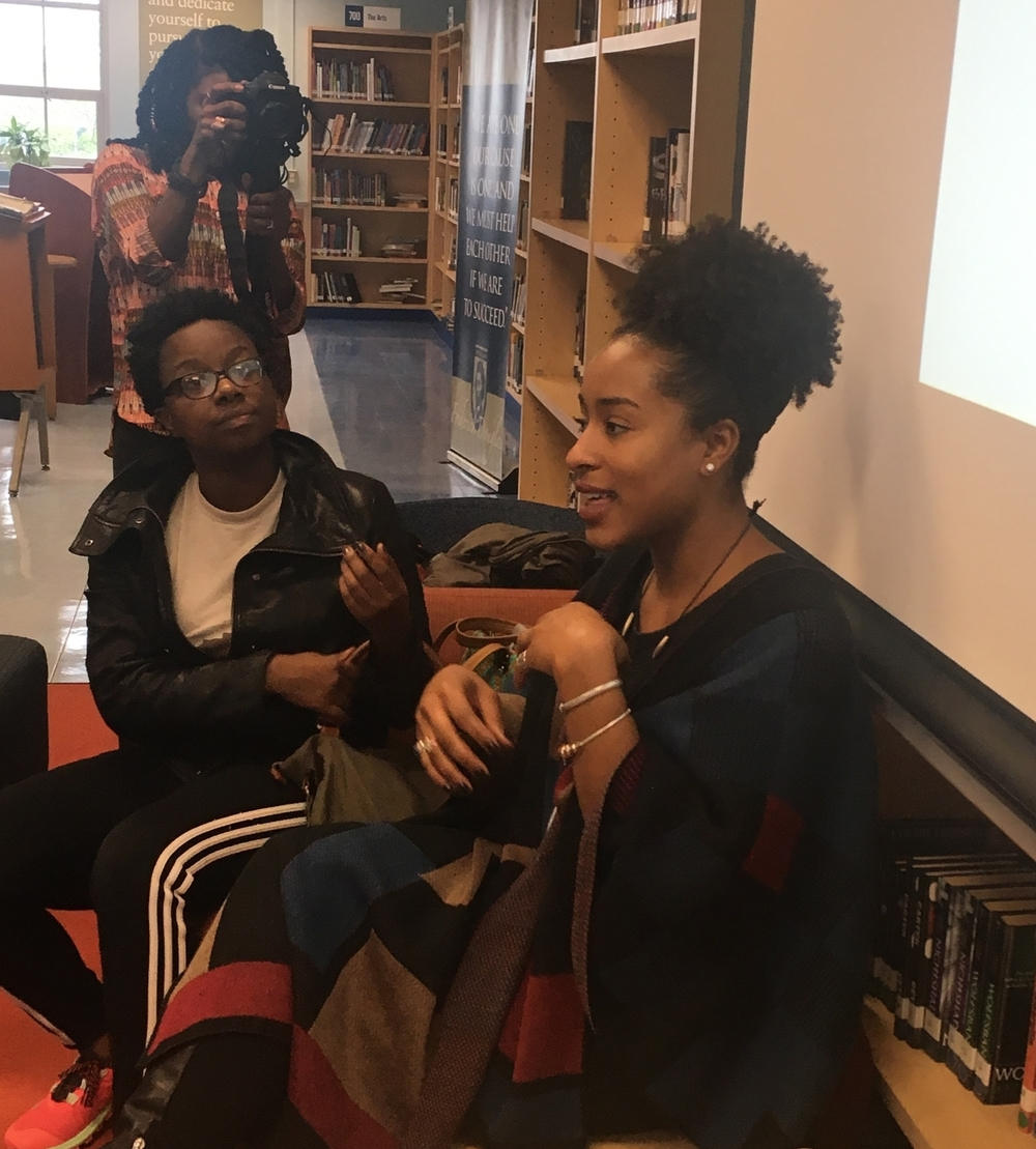 Co-Founder Jasmine Hall sharing with students.     Pictured with guest speaker, Nia Hampton, and Amberly Ellis, filming.