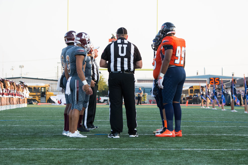 Sachse and Mesquite team captains await the coin flip.