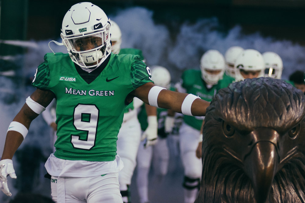 UNT's Jalen Guyton runs out of the tunnel. | Shot with Nikon D7200 w/ Nikkor 80-200 f2.8