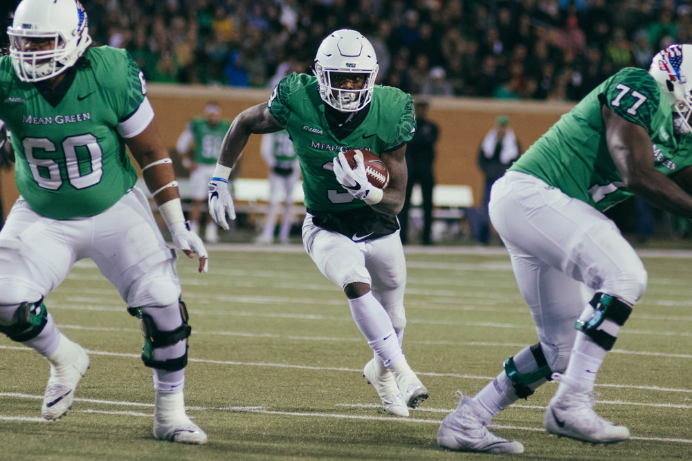 UNT's Jeffery Wilson rushes through the gap.