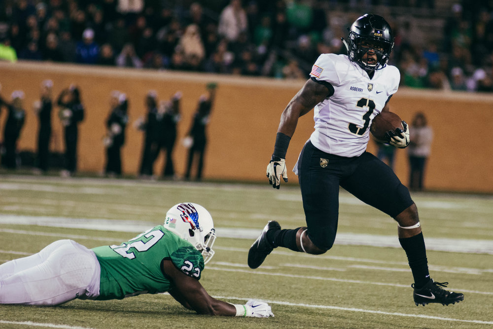 Army's Jordan Asberry rushes past a missed UNT tackle.