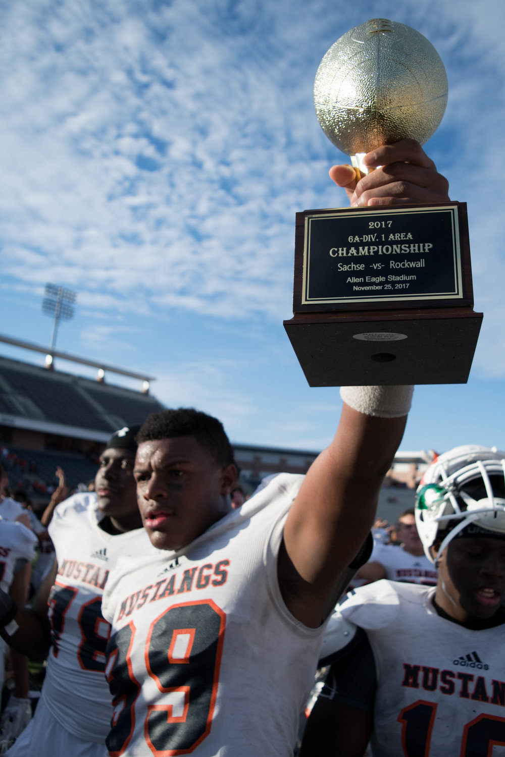 Sachse's Tyler Lacy holds up the UIL Division 1 Area Championship trophy | Shot with Nikon D500 w/ Nikkor DX 18-55 f3.5-5.6 GII