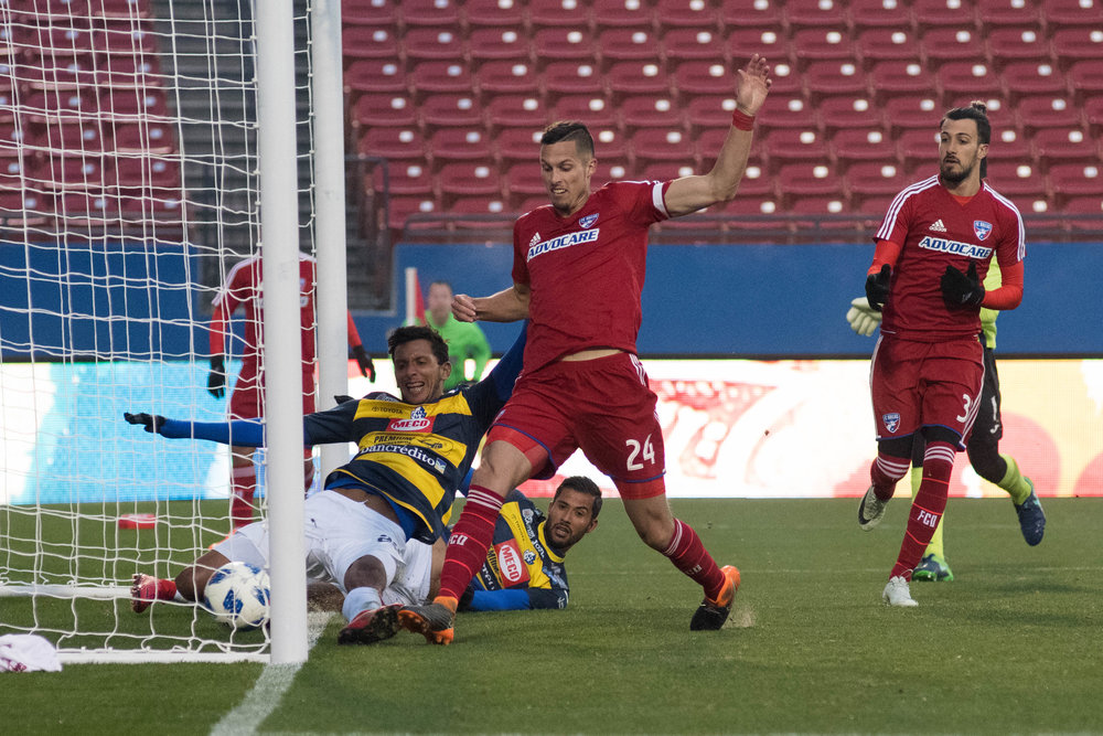 FC Dallas Matt Hedges scores a goal against CS Cartagines (Also the image that was stolen by newspaper  La Nación  | Shot with Nikon D500 w/ Nikkor 80-200 f2.8
