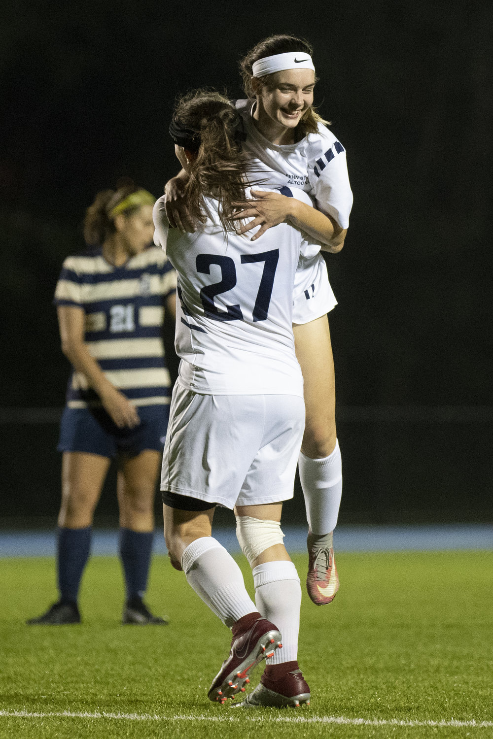 Penn State Altoona Women's Soccer player Sadie McConnell (#11) celebrates her goal with teammate Kierra Irwin (#27) in Altoona's 4-1 win against Juniata College on Wednesday, September 19th, 2018 at Spring Run Stadium. - Photo By: Noah Riffe
