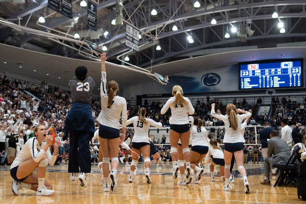 Penn State Women's Volleyball team celebrates during the game against Nebraska at Rec Hall on Saturday, October 13, 2018. The Nittany Lions defeat Nebraska in 3-2 sets. | Photo by: Noah Riffe