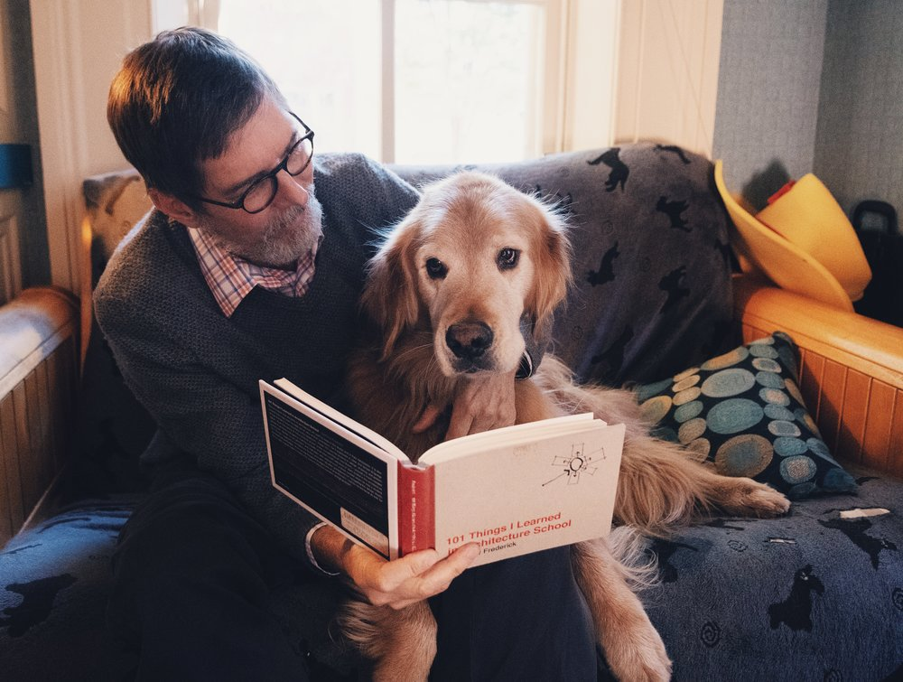 Architect Pat Baechle reads with his dog at his office on Thursday, Oct. 18 2018 in Holidaysburg, PA. | Photo by: Noah Riffe