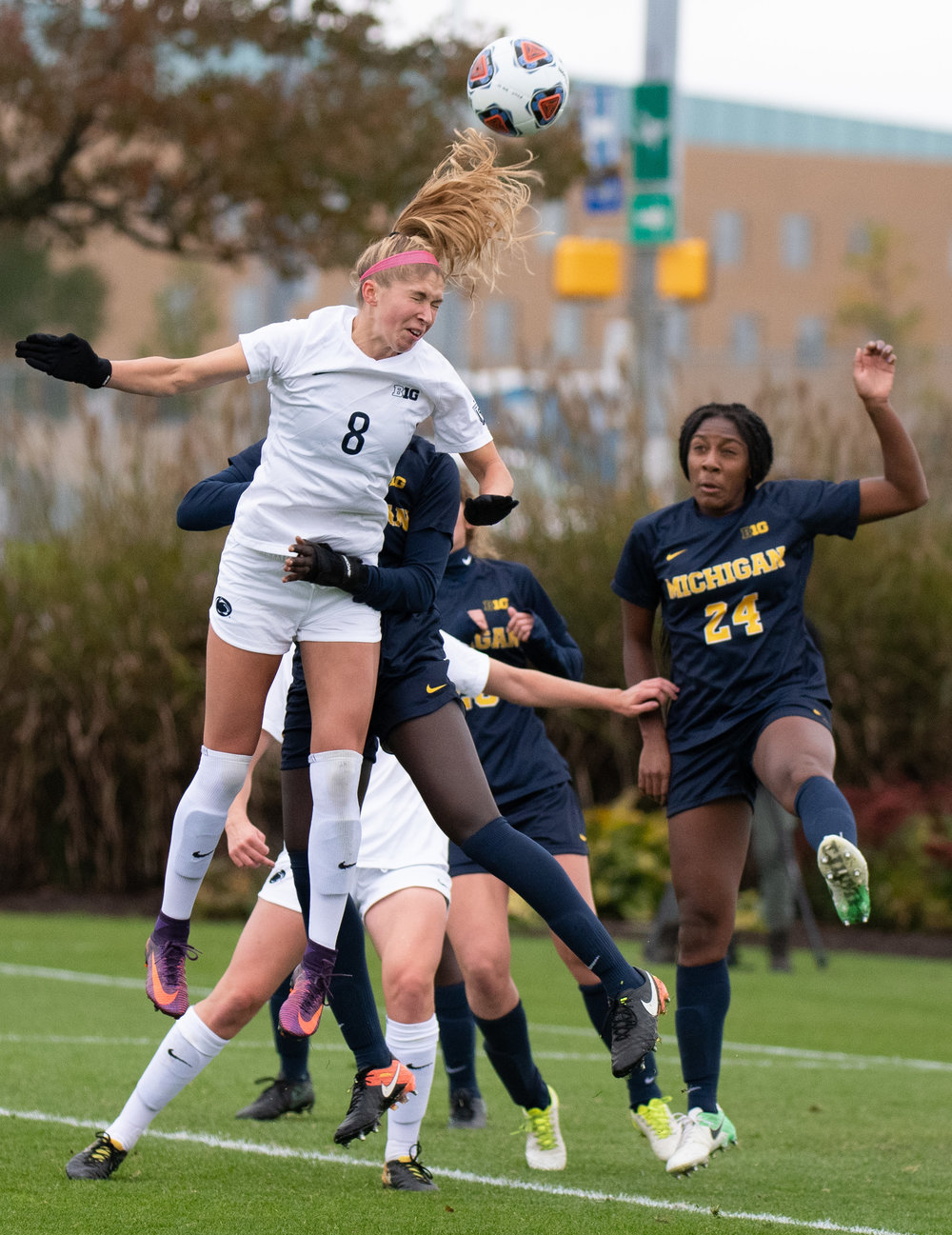 Forward Kristin Schnurr (8) heads the ball during the Big Ten tournament game against Michigan at Jeffrey Field on Sunday, Oct. 28, 2018. The Nittany Lions defeat Michigan 1-0 and advance to the semifinals of the Big Ten tournament. | Photo by: Noah Riffe