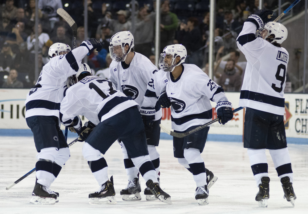 Penn State men's hockey celebrates with teammates during game against Arizona State at Pegula Ice Arena on Saturday, Nov. 3, 2018. The Nittany Lions fall to Arizona State 4-3 in overtime. | Photo by: Noah Riffe