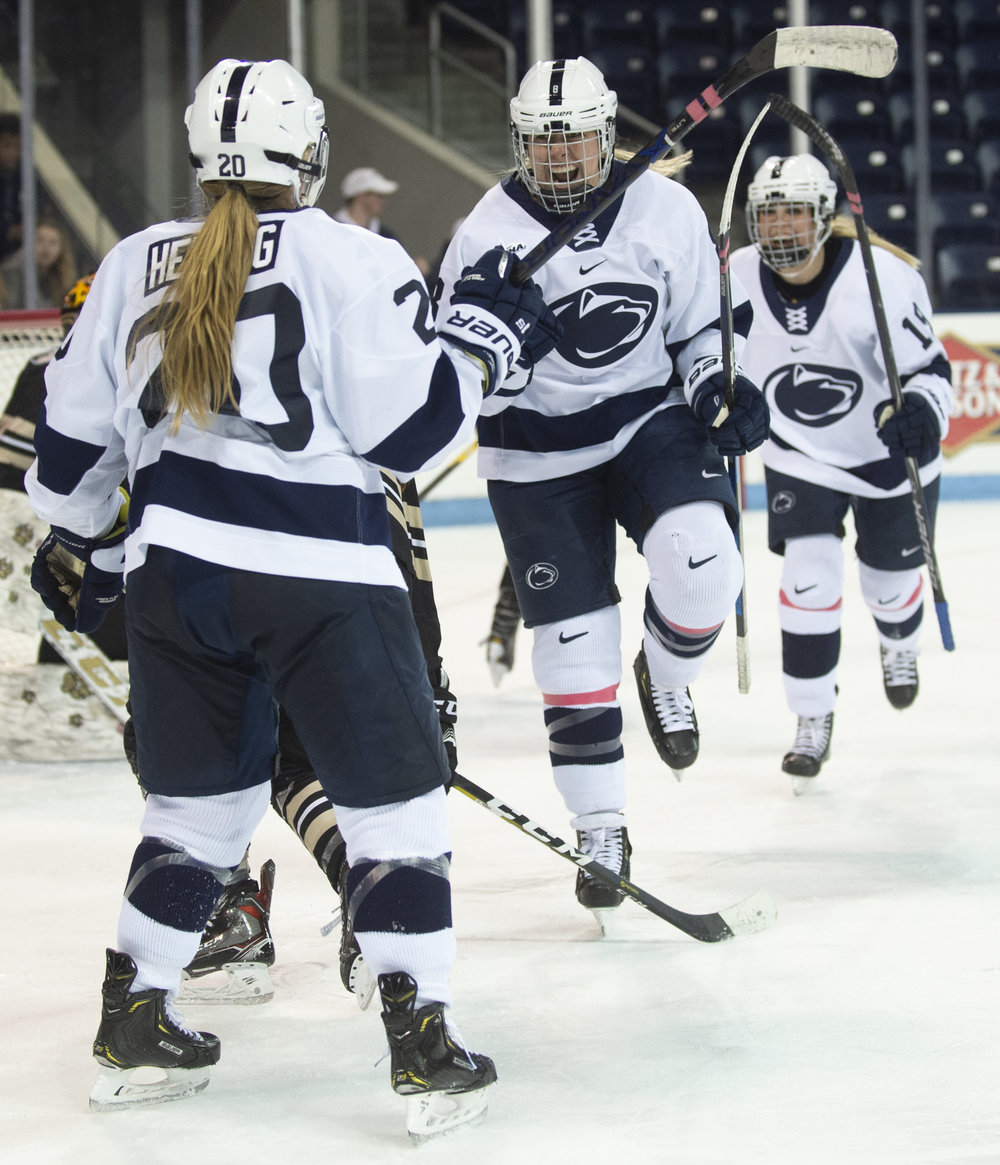 Forward Christi Vetter (8) celebrates with forward Natalie Heising (20) during the women's hockey game against Lindenwood at Pegula Ice Arena on Jan. 21, 2019. The Nittany Lions defeat Lindenwood 2-1 and secure a series sweep. - Photo by: Noah Riffe