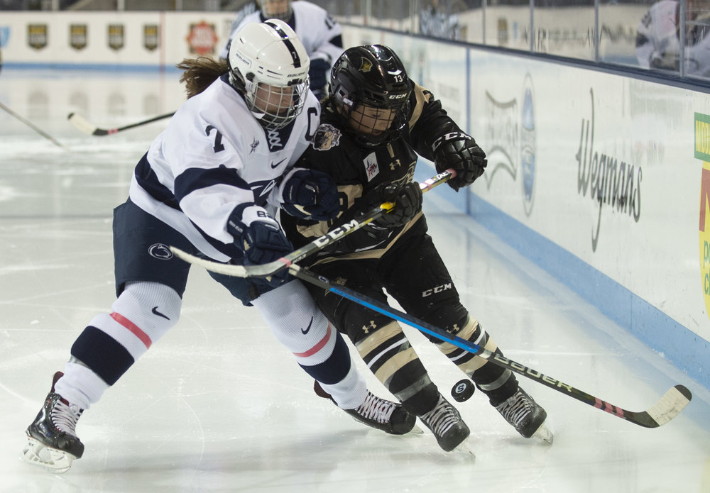 Defender Kelsey Crow (7) battles for the puck during the women's hockey game against Lindenwood at Pegula Ice Arena on Jan. 21, 2019. The Nittany Lions defeat Lindenwood 2-1 and secure a series sweep. - Photo by: Noah Riffe